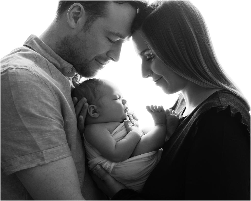 tiny baby studio newcastle newborn photographer parents backlit
